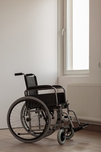 Empty Wheelchair in a Nursing Home