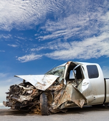 Front End of a Vehicle After a Collision With a Semi-Truck