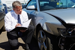 Inspector Calculating the Diminished Value of a Wrecked Car