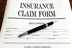 Insurance Claim Form With a Pen After a Car Wreck