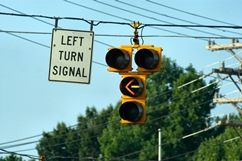 Left Turn Signal Sign With a Turn Light