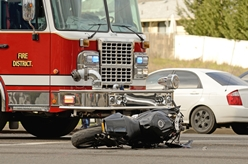 Scene of a Motorcycle Accident With a Fire Truck in the Background