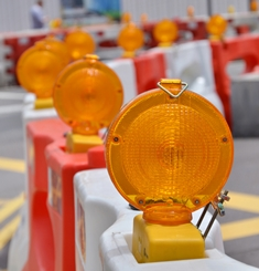Orange Construction Barrels in a Construction Zone