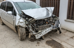 Silver Car After a Head-On Collision