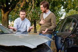 Two Drivers Discussing Fault After a Collision