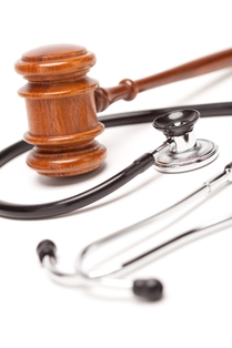 Close-Up View of a Black Stethoscope and Wooden Gavel