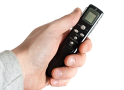 Hand Holding a Voice Recorder
