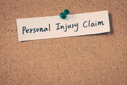 Personal Injury Claim Paper on a Bulletin Board