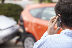 A Driver on a Cellphone After a Car Crash
