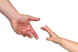 Child reaching for parent