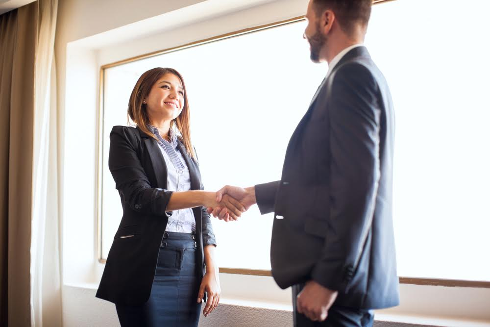 woman shaking hands with real estate attorney