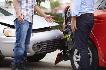 Florida drivers discussing no-fault insurance after car accident