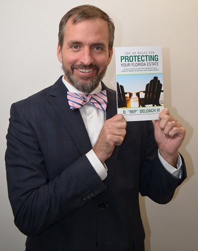 Rep DeLoach holding his free Florida Estate Planning Book