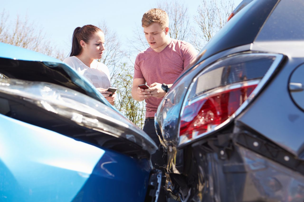 Drivers exchanging information after an accident