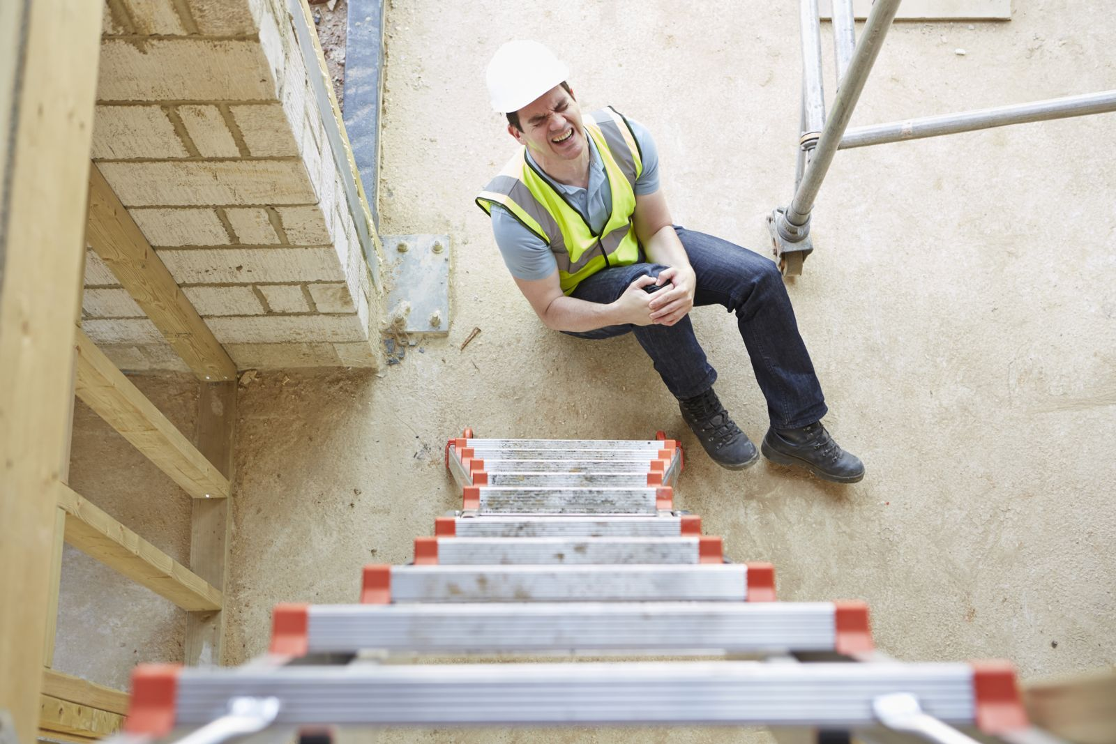 Man in pain after falling from ladder