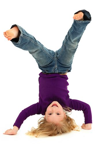 Barefoot child upside-down
