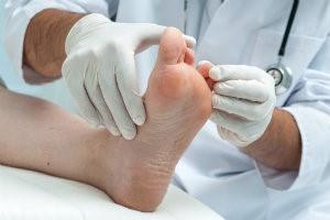 Doctor examining foot