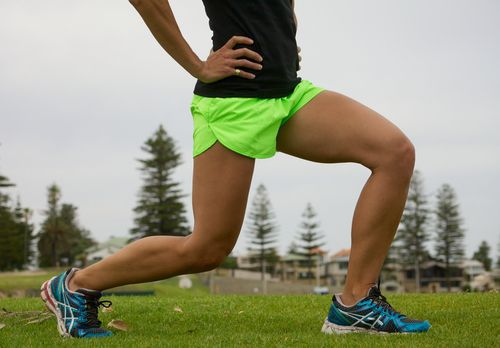 Female runner doing lunges