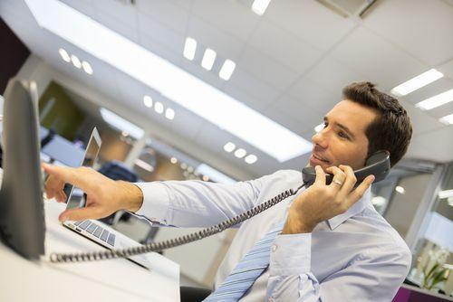Man Taking Intake Calls