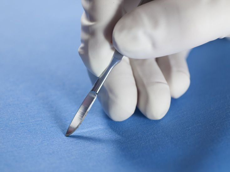 Scalpel and Gloved Hand