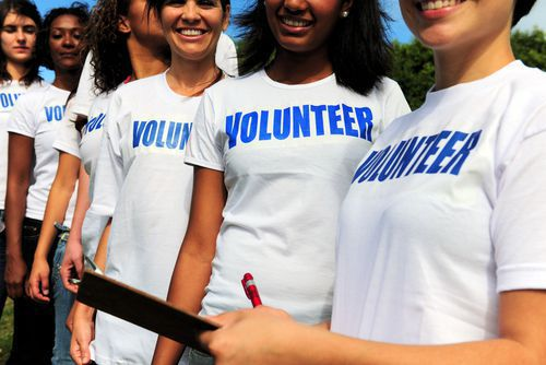 People with Volunteer Shirts