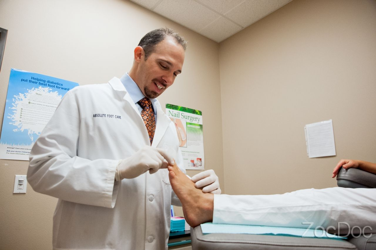 Our doctor treating patient's foot pain