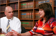 Injury law attorney Paul Cavonis with his client