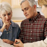 Attorney discussing VA benefits with elder law clients