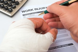 Injured worker filling out a work injury form