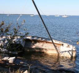 River accidents like these overturned boats often occur in Louisiana rivers.