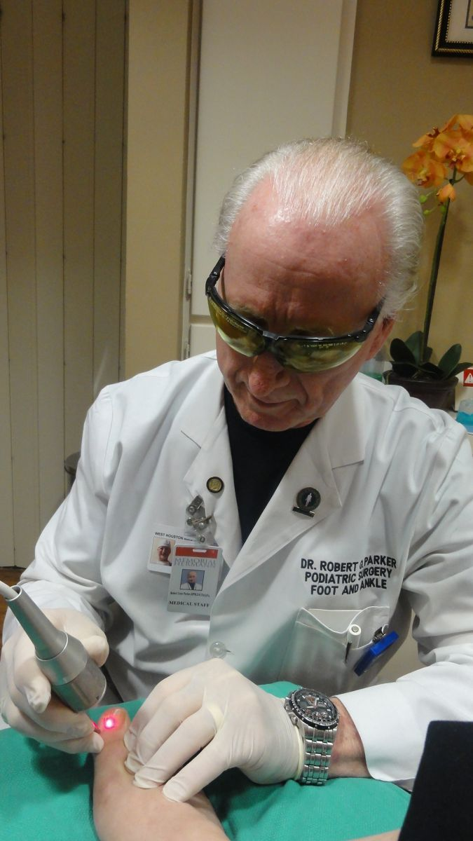 Dr. Parker performing laser treatment for fungal toenail