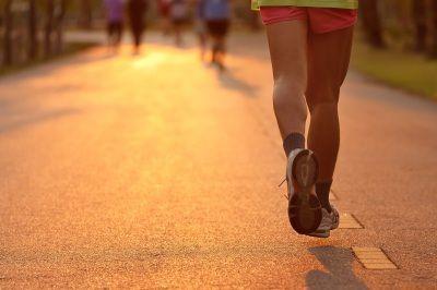 Woman Running Marathon at Sunset