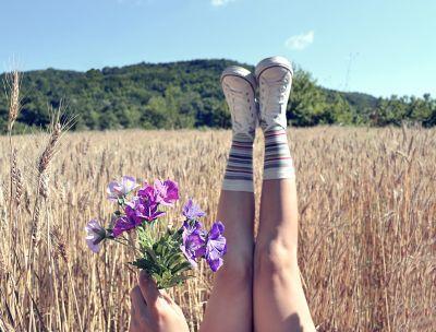 Feet in Air in Field