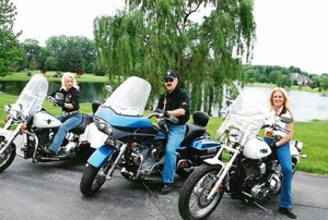 Regina and Randy riding motorcycles in Indiana