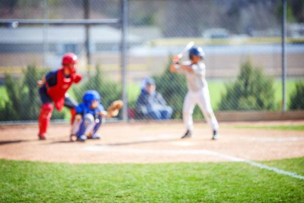Baseball player at bat with helmet