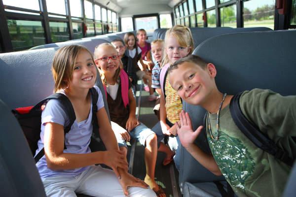 School children riding on bus