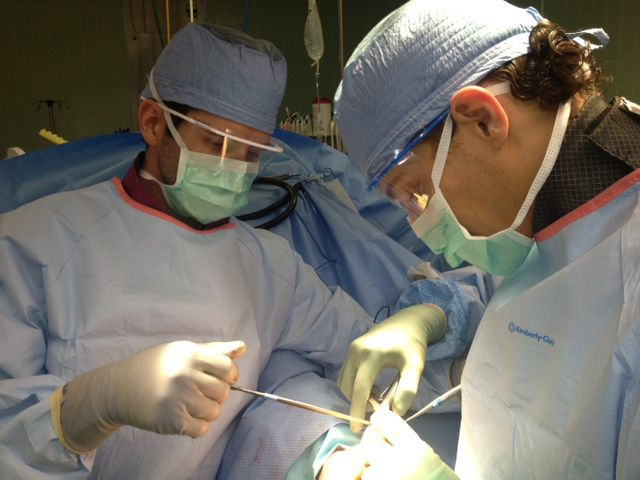 Dr. Gerber and another surgeon performing surgery on a foot.