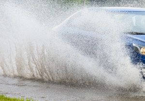 car driving in a puddle