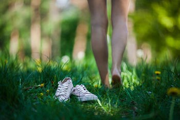walking barefoot through grass