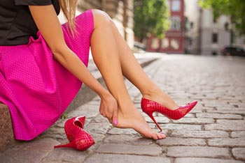 woman pink dress holding heel