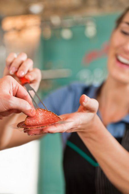 Woman Giving Free Sausage