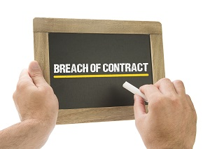Breach of contract is recorded in chalk on a blackboard