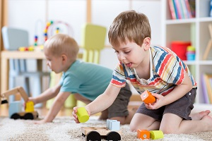 Children play with toys at their daycare facility