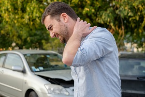 Neck pain after a traffic collision can be a sign of a serious injury
