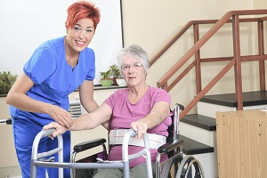 Female patient must rely on a wheelchair and walker after a bone fracture