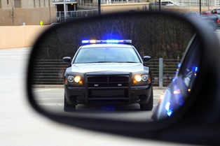 Police Car and Officer Issuing Traffic Infraction in Virginia