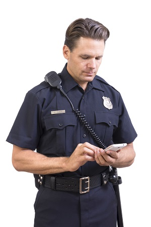 Police officer looking through phone