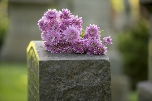 Headstone with flowers on it