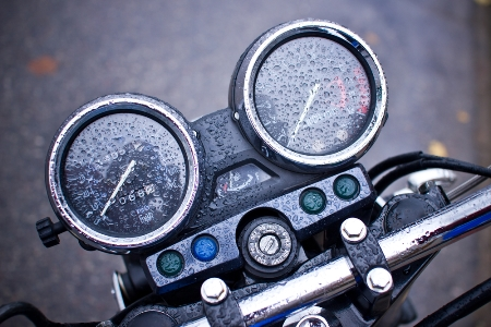 Motorcycle gauges wet with raindrops