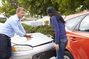 Two people arguing over car accident